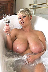 Bea flora in bathtub with champagne.